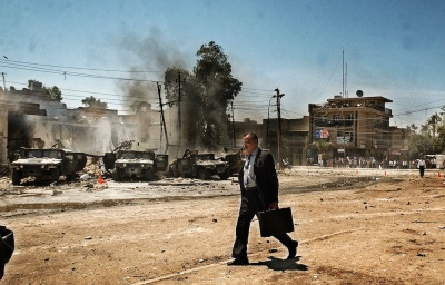 IRAQ. Baghdad, Iraq. Monday, April 26, 2004. An Iraqi man walks by the scene of an attack on US Army Humvee's that caused several American casualties in the Al-Waziriyah neighborhood of Baghdad.  Contact email: New York : photography@magnumphotos.com Paris : magnum@magnumphotos.fr London : magnum@magnumphotos.co.uk Tokyo : tokyo@magnumphotos.co.jp   Contact phones: New York : +1 212 929 6000 Paris: + 33 1 53 42 50 00 London: + 44 20 7490 1771 Tokyo: + 81 3 3219 0771   Image URL: http://www.magnumphotos.com/Archive/C.aspx?VP3=ViewBox_VPage&IID=2K7O3RTQLB31&CT=Image&IT=ZoomImage01_VForm